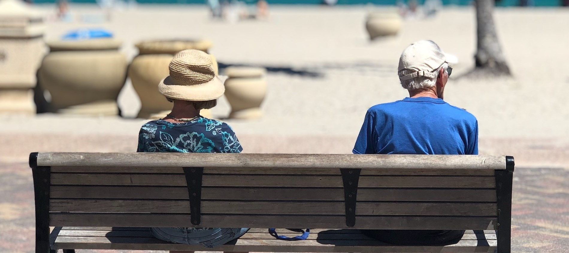 older adults sitting on bench