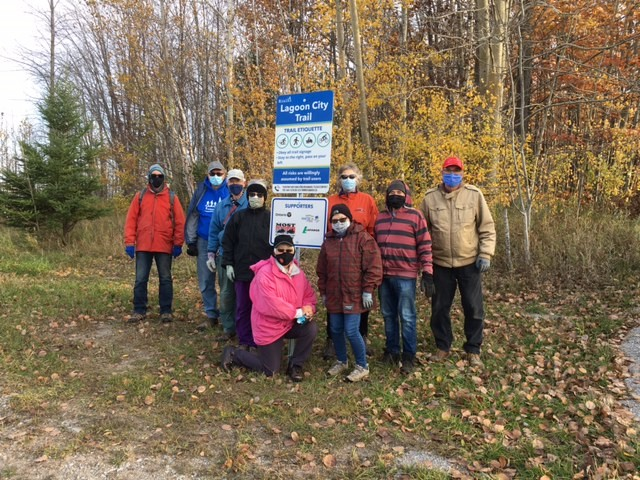 Picture of Trails Committee around Lagoon City Trail sign