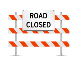 Picture of barricades with the words 'road closed'